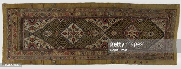 Oriental carpet Eastern medallion or raster rug made of knotted wool runner size There are two elongated medallions in the midfield and four edges...