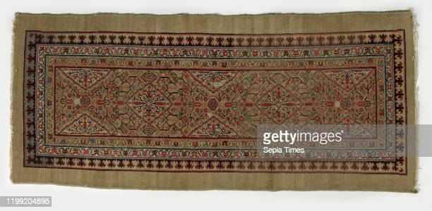 Oriental carpet medallion rug made of knotted wool runner size There are two diamondshaped medallions in the midfield and three half medallions along...