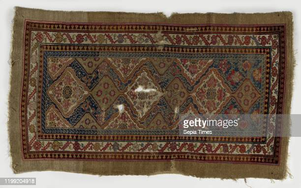 Oriental carpet medallion rug made of knotted wool There are six diamondshaped medallions palmettes and rosettes in midfield Medallions cut in half...