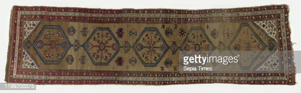 Oriental carpet Oriental carpet in carpet format the midfield of which is decorated with five medallions filled with hexagonal motifs and animal...