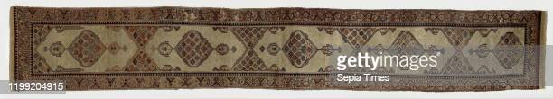 Oriental carpet Oriental carpet of knotted wool carpet size In the midfield are two medallions with grid work rosettes and heart shapes Around three...