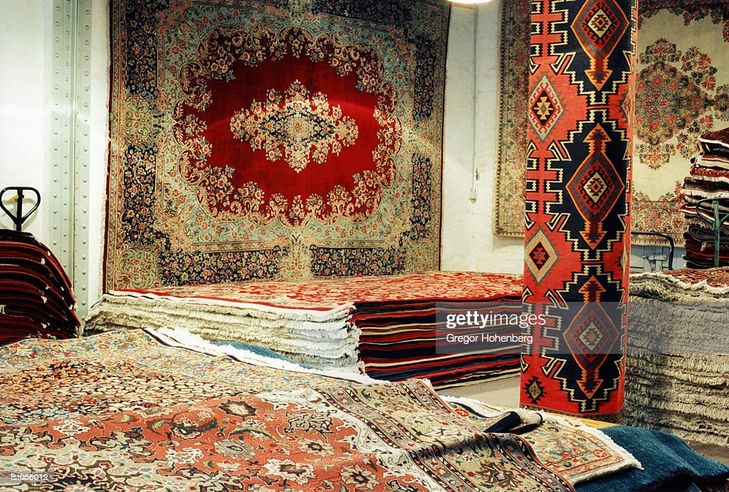 Oriental carpets in a shop : Stock Photo