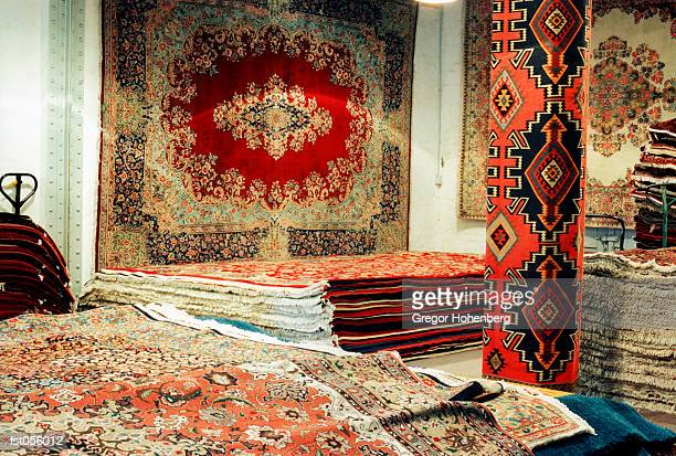oriental carpets in a shop - persian rug stock photos and pictures