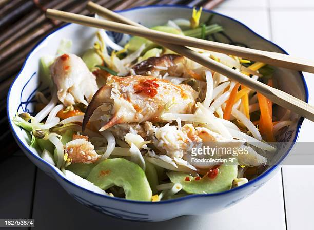 oriental crab salad with chopsticks - chilli crab stock photos and pictures