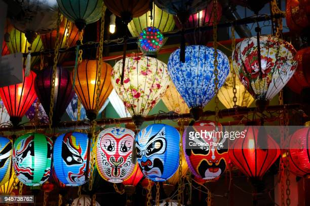 oriental masks and lanterns. - chinatown stock photos and pictures