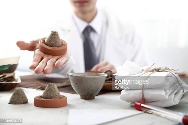 Oriental medical doctor holding moxibustion
