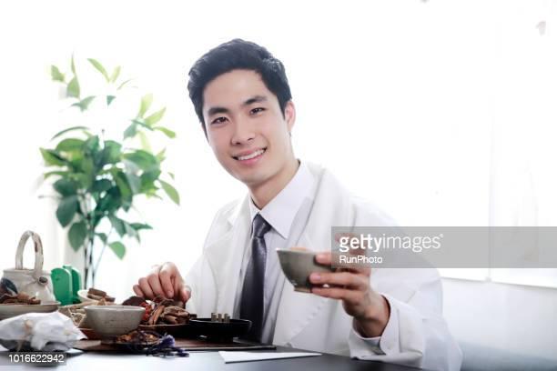 Oriental medical doctor holding oriental medicine