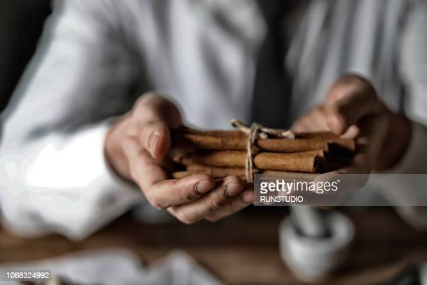 Oriental medical doctor with cinnamon
