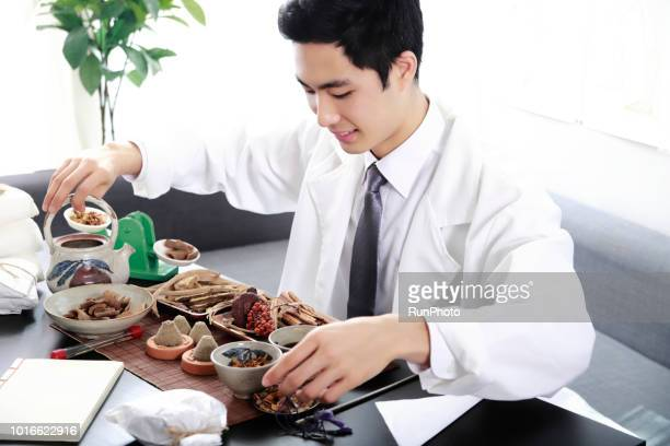 Oriental medical doctor with Various dried herbal medicine