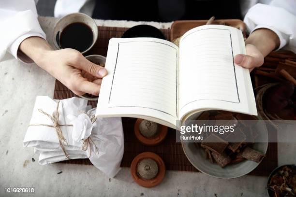 Oriental medicine doctor reading book