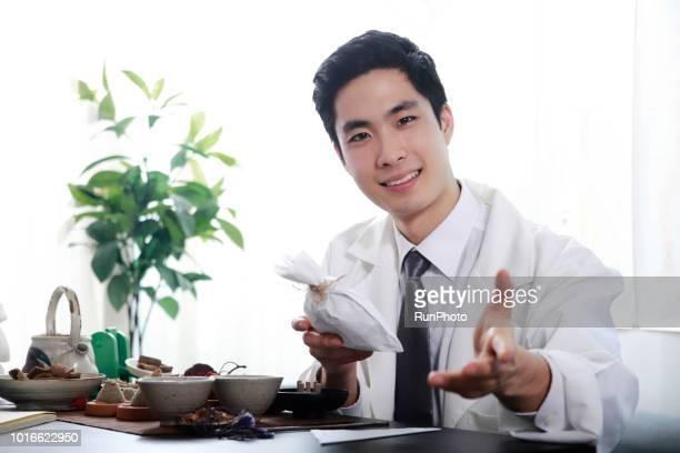 Oriental medicine doctor with prescription bag