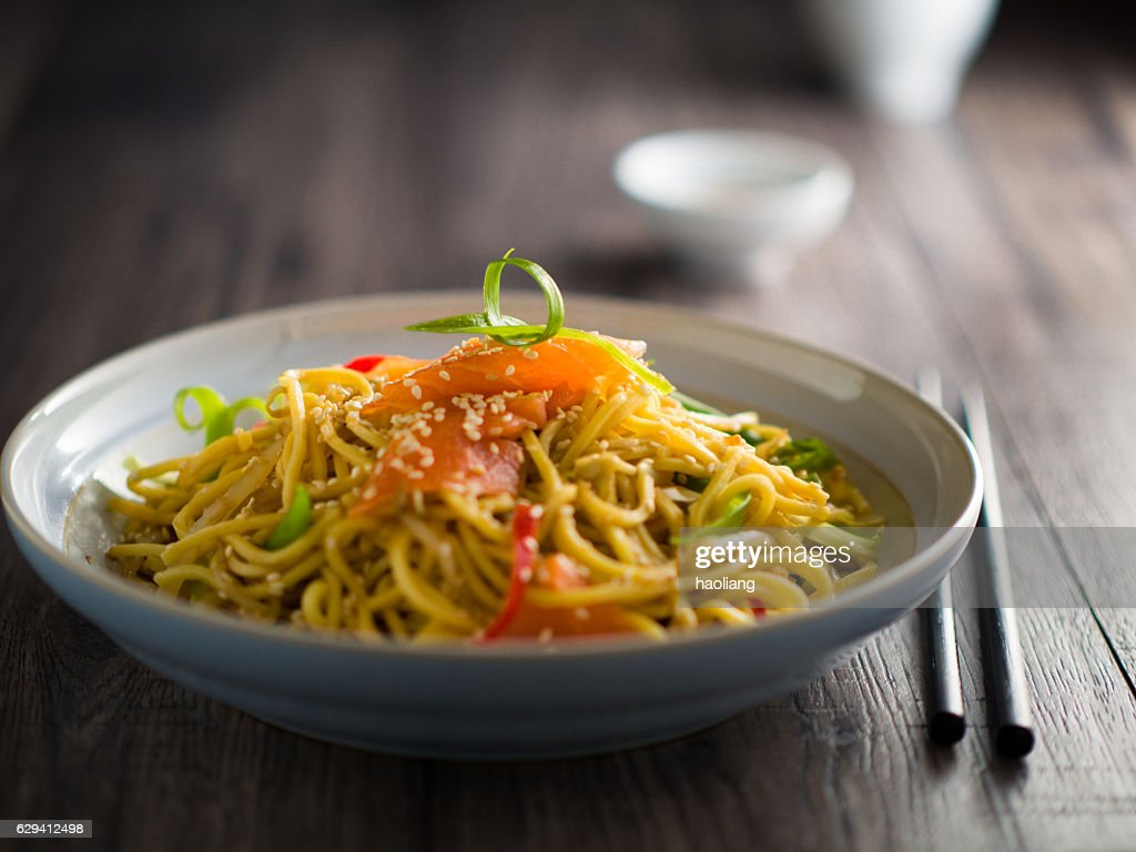 Oriental noodles salad with smoke salmon : Stock Photo