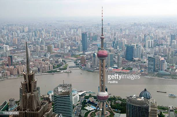 oriental pearl tower and the bund shanghai - pavliha stock photos and pictures