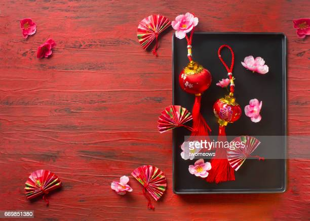 Oriental style decorative item on red rustic background.
