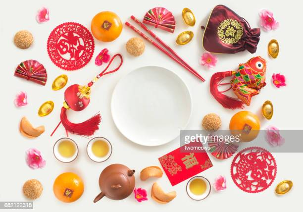 Oriental style decorative items and Chinese food snack on white background.