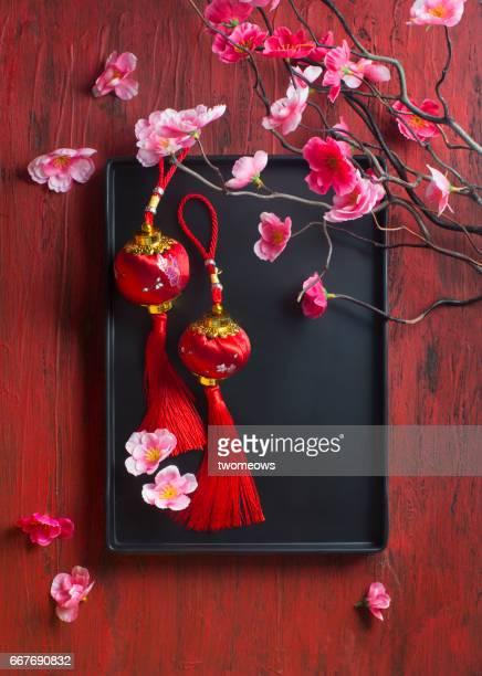 Oriental style lantern decorative items on red background.