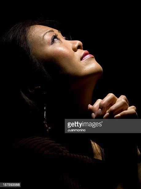 Oriental woman praying