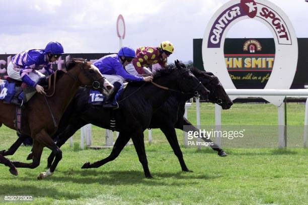 Orientor with jockey Kieren Fallon wins ahead of Country Reel with jockey Jamie Spencer and Danger Over with jockey Martin Dwyer in the Kronenbourg...