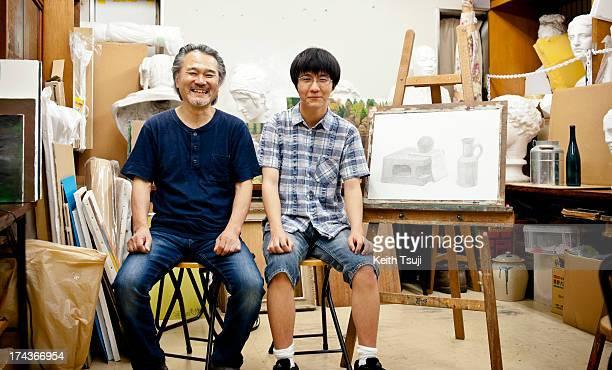 Origami artist Toma Takeda poses for a photo with his drawing teacher Mr Sakurai on July 17 2013 in Yokohama Japan Selftaught origami artist Toma...