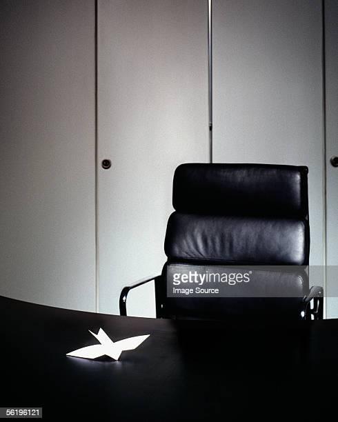 Origami bird on office desk