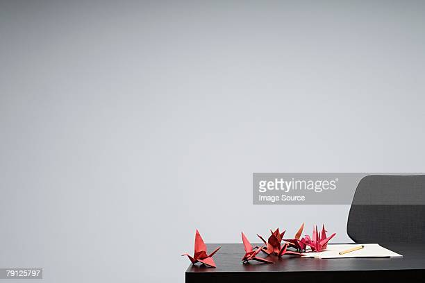 Origami birds in a row on a desk