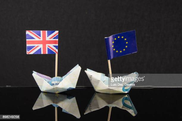 origami boats made with euro banknotes and their flags - brexit stock pictures, royalty-free photos & images