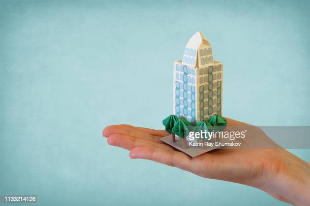 origami condo in my hand - art and craft product stock pictures, royalty-free photos & images