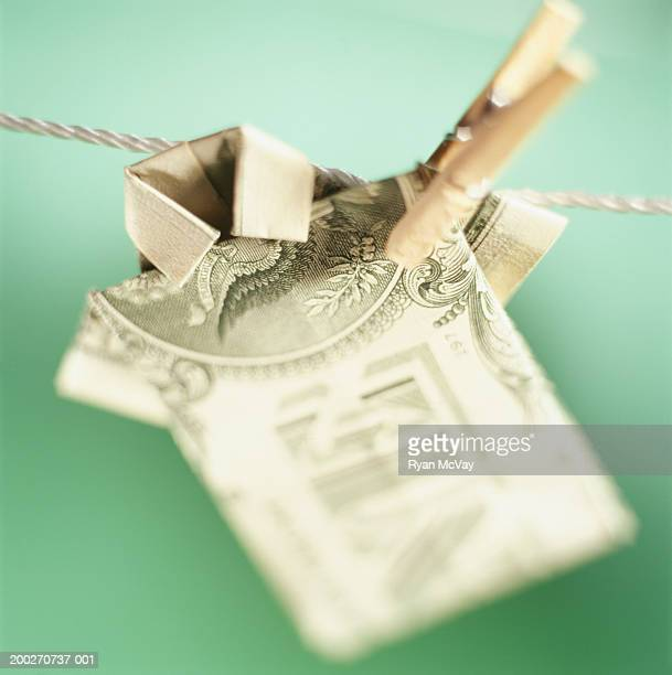 Origami dollar shirt on clothesline, close-up