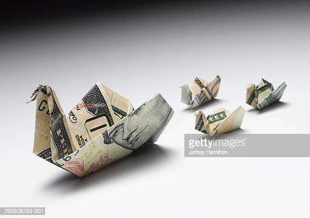 Origami duck and ducklings made out of US dollar banknotes, close-up