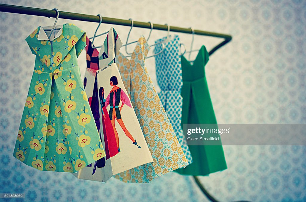 origami fashion paper patterned dresses hanging on a