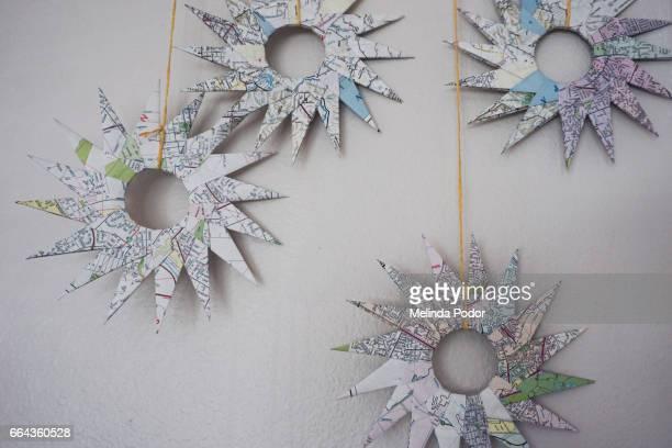 Origami ninja stars folded from recycled maps