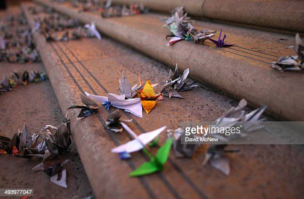 Origami paper cranes made by UCLA students as a gesture of peace are placed on steps where students of UCSB and UCLA mourned at a candlelight vigil...
