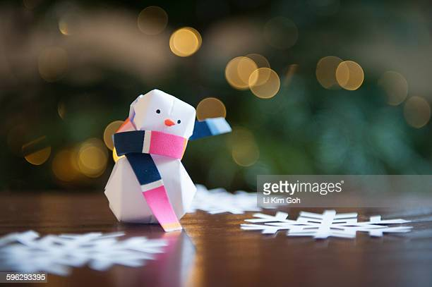 Origami Snowman with scarf blowing in air