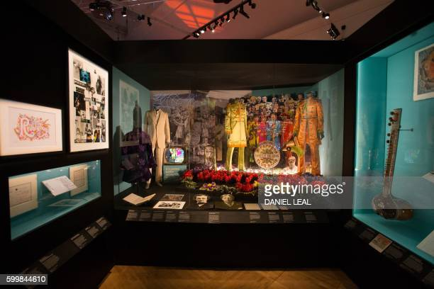 Original and replica costumes from the British band The Beatles used on the album cover of Sgt Pepper's Lonely Hearts Club Band are pictured on...