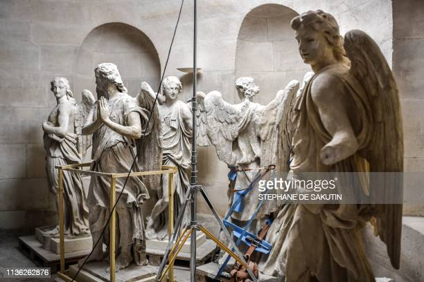 Original angels sculptures, formerly set on the church's dome, are on display in the crypt of the Notre-Dame du Val-de-Grace church in central Paris...