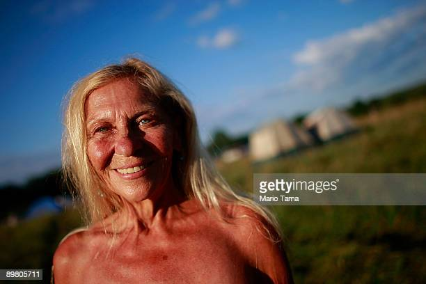 Original attendee Sue Babudro stands outside her tent as the 40th anniversary of the Woodstock music festival approaches August 14 2009 in Bethel New...