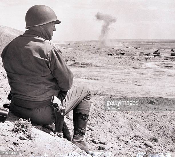 1943Tunisia Lieutenant General George S Patton Jr Commander of the US Second Corps in Tunisia is sitting on a hill overlooking the battlefield...