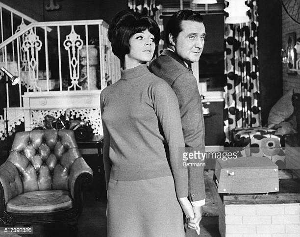8/1968 Patrick MacNee and Linda Thorson in a scene from the British TV series The Avengers They are shown standing backtoback holding hands