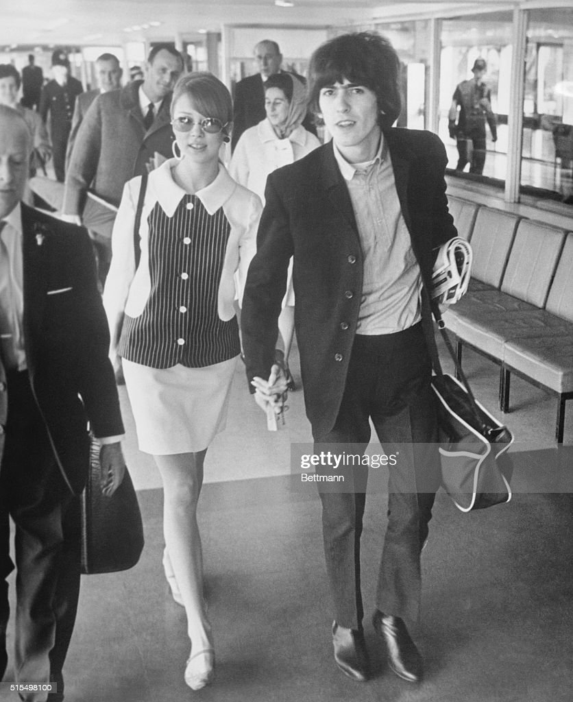 Beatle George Harrison And His Wife Former Model Patti Boyd Walk To Their Plane