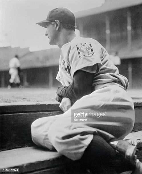 Benched at his own request after running up a record string of 2130 consecutive games 'Iron Man' Lou Gehrig of the New York Yankees is shown watching...