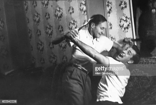Bill and Jack locked in mortal combat with Moroccan dagger broomstick club on the couch 206 East 7th Street Fall 1953 Jack came in weekends from...