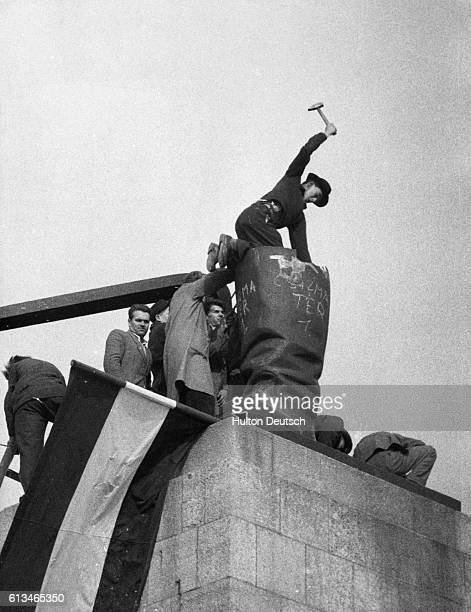Eight 'Freedom Fighters' Breaking Up A Statue Of Stalin Additional Hulton Text Hungary's Last Battle For Freedom