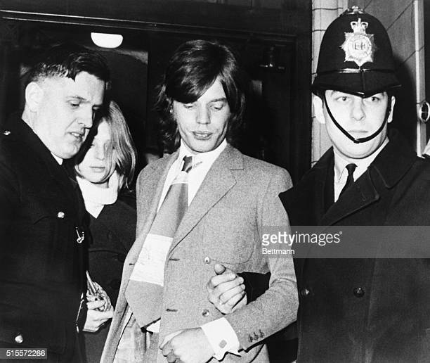 Policemen escort Rolling Stones lead performer Mick Jagger and his former girlfriend, Marianne Faithfull from court Jan. 26 after they were fined...