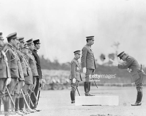 Message from the Emperor. Tokyo, Japan: His Majesty, Emperor Hirohito of Japan, delivering his message to War Minister Lieutenent General Hideki...