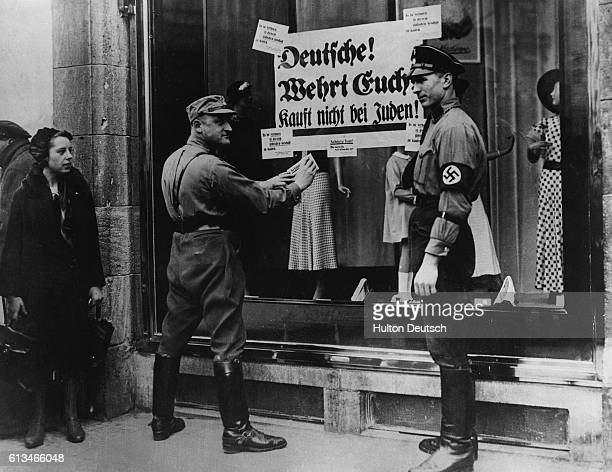 Original caption: Nazi Pickets Outside a Jewish Shop In Berlin During Anti-Jewish Campaign.