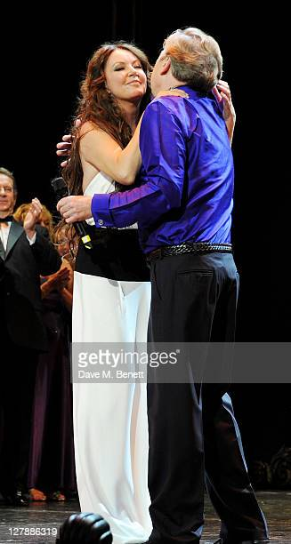 Original Christine Sarah Brightman and Lord Andrew Lloyd Webber bow on stage during the 25th Anniversary performance of Andrew Lloyd Webber's 'The...