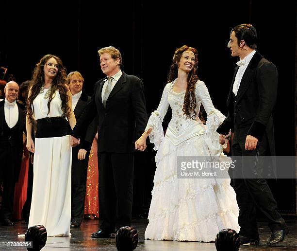 Original Christine Sarah Brightman original Phantom Michael Crawford actress Sierra Boggess and actor Ramin Karimloo bow on stage during the 25th...