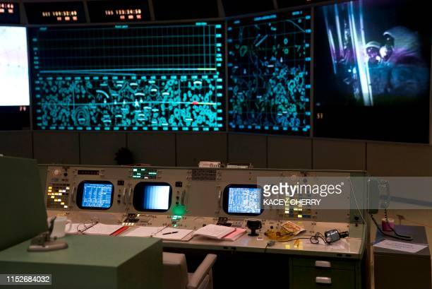 Original flight control consoles are shown inside the newly restored Apollo Mission Control Room at NASA's Johnson Space Center in Houston on June 28...