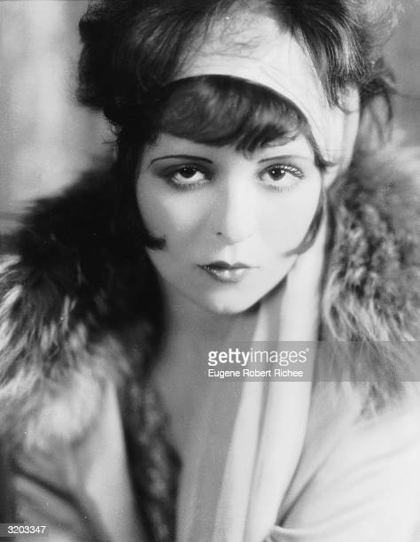 Original 'It Girl' Clara Bow in headscarf and furtrimmed coat