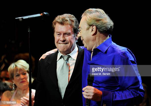 Original Phantom Michael Crawford and Lord Andrew Lloyd Webber bow on stage during the 25th Anniversary performance of Andrew Lloyd Webber's The...